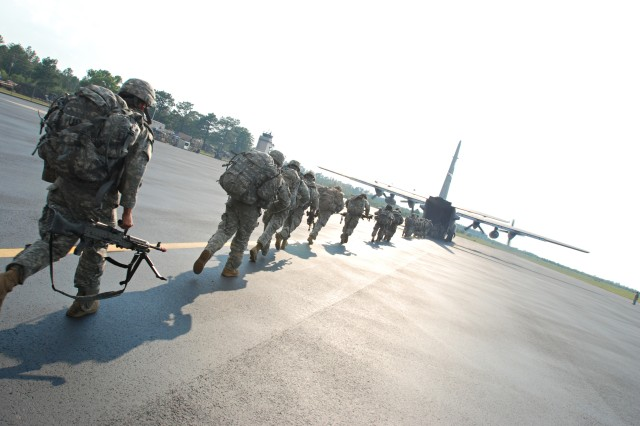 Paratroopers from the 2nd Brigade Combat Team, 82nd Airborne Division, hurry up the ramp of a C-130 aircraft waiting to extract them at the completion of a noncombatant evacuation exercise conducted by the 2nd BCT at Camp Mackall, N.C. June 24-26. The exercise tested the unit's capability to deploy on short notice to help evacuate American citizens and others trapped in a war-torn foreign country.