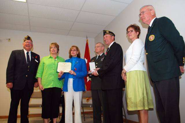 Family members and dignitaries gather following the presentation ceremony. From left to right are: Harlan Borton, commander, American Legion Post No. 334, Linda Saveraid and Nancy Sebring, daughters of Harry Rasmusson, Maj. Gen. Robert M. Radin, commanding general, U.S. Army Sustainment Command, Jim and Nina Rasmusson, siblings of Harry Rasmusson, and retired Brig. Gen. J. Daniel McGowan, Iowa civilian aide to the Secretary of the Army.