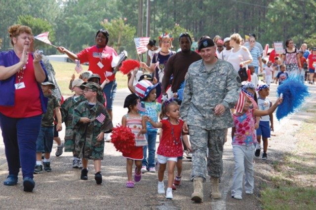 Fort Polk's Child Development Center went all out June 19 in helping Army kids understand -- and celebrate -- the Army's 234th birthday. CDC and Family Child Care kids got to march in a pint-sized parade decorated with patriotic colors and symbols. Some dads even got to participate (or lend their uniforms).