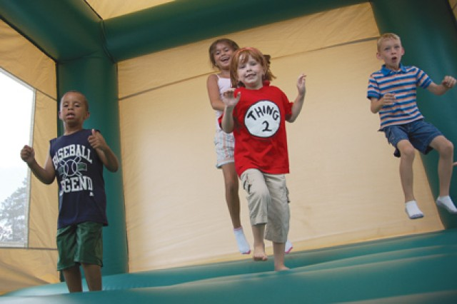 It's never too hot to jump around in an inflatable as these Polk children demonstrate.
