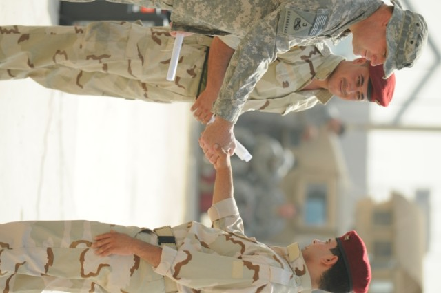 Baghdad - Lt. Col. Bernard Williford, of Burgaw, N.C., shakes the hand of a graduate from the staff development course, June 15. Williford, commander of 230th Brigade Support Battalion, 30th Heavy Brigade Combat Team, is part of the group of Soldiers who help the 17th Division Iraqi Army, Motorized Transportation Regiment, train at Forward Operating Base Falcon, south of Baghdad.