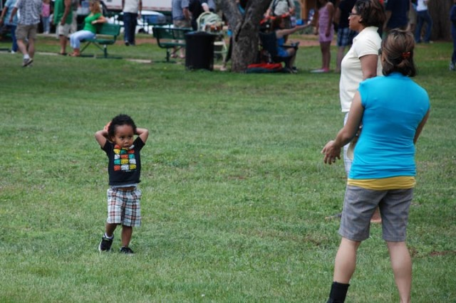 Malachi Boone plays catch with his mom Sgt. Dianalou Boone of the 1st Space Brigade during the 2009 U.S. Army Space and Missile Defense Command/Army Forces Strategic Command Organization Day, June 12.