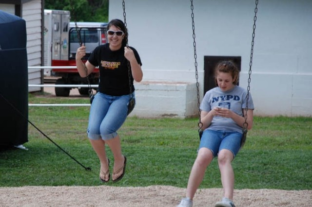 Sylvia and Sydney Hartman, daughters of Sharon Hartman from the Public Affairs Office, insist you are never too old to swing.