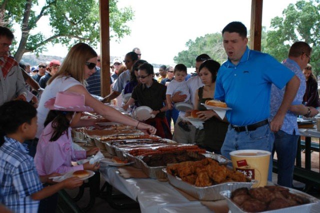 A wide assortment of food was served, including burgers, hot dogs, bratwurst and fried chicken, as well as various side dishes and desserts.