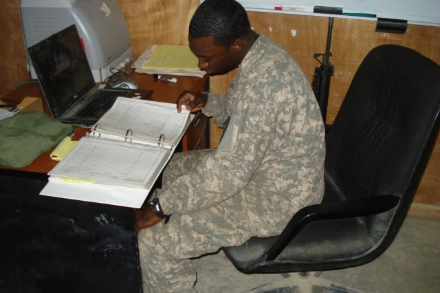 BAGHDAD - As a unit supply specialist, Spc. Aljalel Eaddy, 46th Engineer Combat Battalion (Heavy), 225th Engineer Brigade, flips through a hand-receipt book of thousands of company items and equipment.  The Gresham, S.C. native uses his exceptional organizational skills to stay on top of all his supply and armorer responsibilities.
