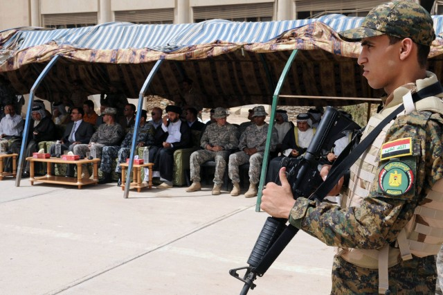 BAGHDAD - An Iraqi Soldier looks on during the transfer ceremony at Joint Security Station Oubaidy, June 20, in the 9 Nissan district of eastern Baghdad. The JSS was officially to the Iraqi Security Forces during the ceremony. The transfer falls under the terms of the U.S.-Iraqi security agreement in which all U.S. combat forces must leave Iraqi urban areas by June 30.
