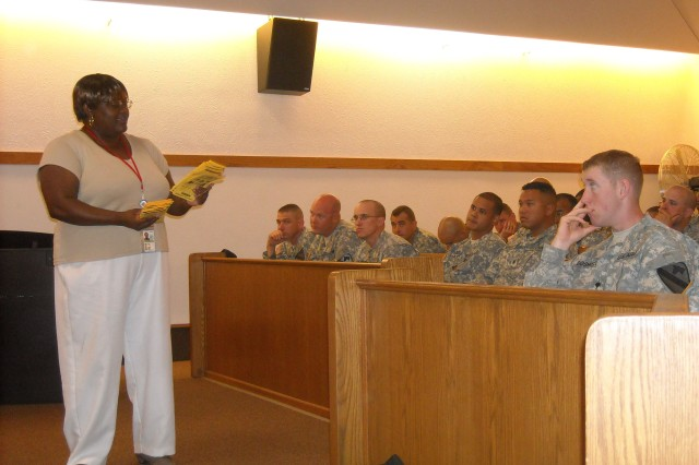 Sharon Jackson, a provider that works with the Family Advocacy Program, speaks with Soldiers assigned to the 4th Brigade Combat Team, 1st Cavalry Division, about the services that help troops adjust to being home, during the Battlemind Training classes at Fort Hood's Palmer Theater June 15.