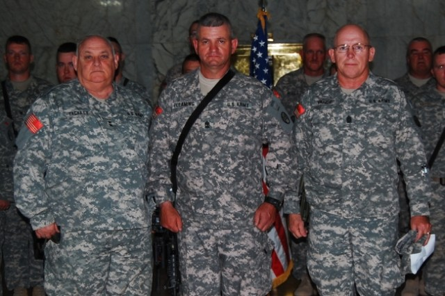 BAGHDAD - Maj. Gen. Allen Tackett (left), the West Virginia National Guard Adjutant General, and the West Virginia State Command Sgt. Maj. Lawrence Vance (right) pose for a photograph with 1st Sgt. Don Fleming of 150th Armored Reconnaissance Squadron, 30th Heavy Brigade Combat Team, after his promotion at the al-Faw Palace, June 17. Tackett and Vance visited with W.Va. troops, here, to address their concerns and boost morale.
