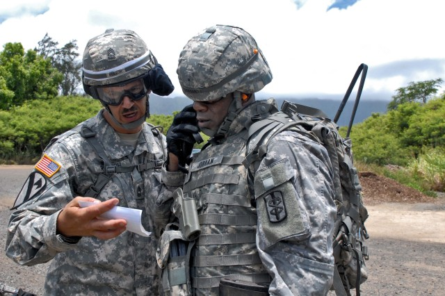 BELLOWS AIR FORCE STATION, Hawaii - Warrant Officer Anthony Jordan, 18th Medical Command, calls in a 9-Line Medical Evacuation with direction from Master Sgt. Carl Roesch, 18th MEDCOM during the unit's first field exercise.