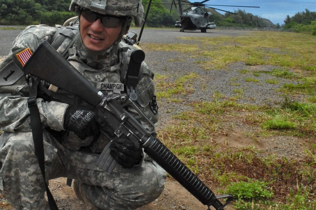 BELLOWS AIR FORCE STATION, Hawaii- Spc. Alexander Champigny, 18th Medical Command, secures a perimeter as Soldiers prepare to load a simulated casualty on a Marine Corps CH-53 helicopter.
