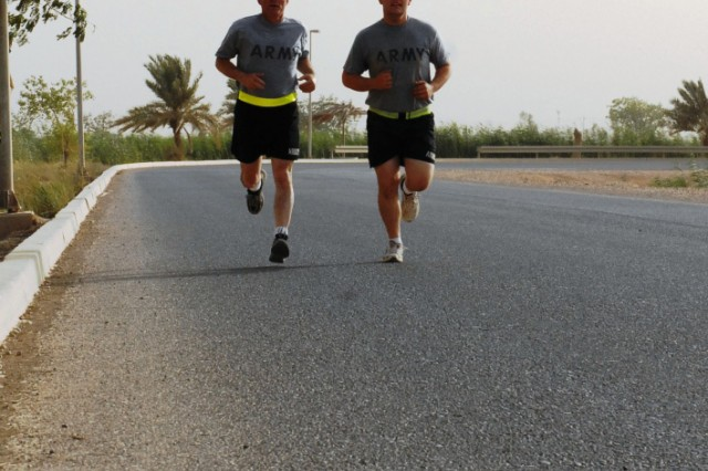 BAGHDAD - Father and son duo, Lt. Col. Jerry S. Crooks (left) and Pfc. Taylor Crooks (right), take a run together around Z Lake on Camp Liberty, June 20. Father's Day was especially meaningful as the two experienced the day in a way they never have before, deployed to Baghdad. The Crooks' are one of two sets of father-son Soldiers deployed with the engineers.