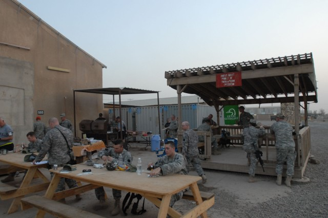 CAMP TAJI, Iraq - Pennsylvania Army National Guard Soldiers enjoy a cookout following the charter meeting of the Camp Taji, Iraq Chapter of Ducks Unlimited June 13. Over 30 new members joined DU during the event or in the week following the kickoff cookout.