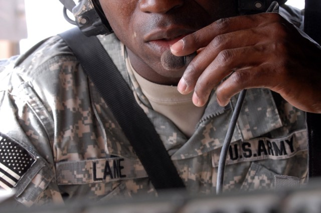 BAGHDAD - Sgt. Andrew Lane, a transportation specialist from Mansfield, La., assigned to Company A, 299th Brigade Support Battalion, 2nd Brigade, 1st Infantry Division, performs radio checks with the battalion tactical operation center prior to the convoy briefing at Camp Liberty, June 22.
