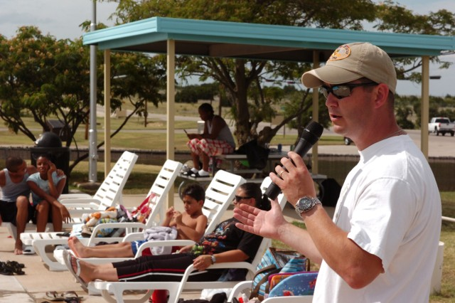 Maj. Daniel Legereit, 1st Air Cavalry Brigade, 1st Cavalry Division, Rear Detachment commander, of Metropolis, Ill., exchanges a few words with Soldiers and family members about summer safety during 1st ACB, 1st Cav. Div.'s Stand-down Safety Day June 19, at the West Fort Hood swimming pool.