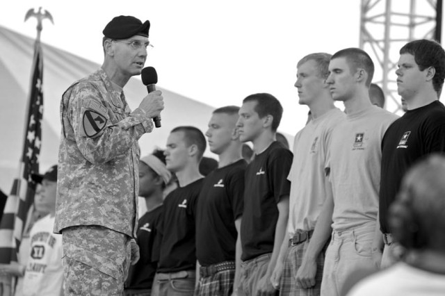 Brig. Gen. Jeffrey E. Phillips, deputy chief of Army public affairs, performed a mass swearing-in ceremony Saturday as part of the Country USA festival events. More than 100 servicemembers were present to cite their oaths of service.