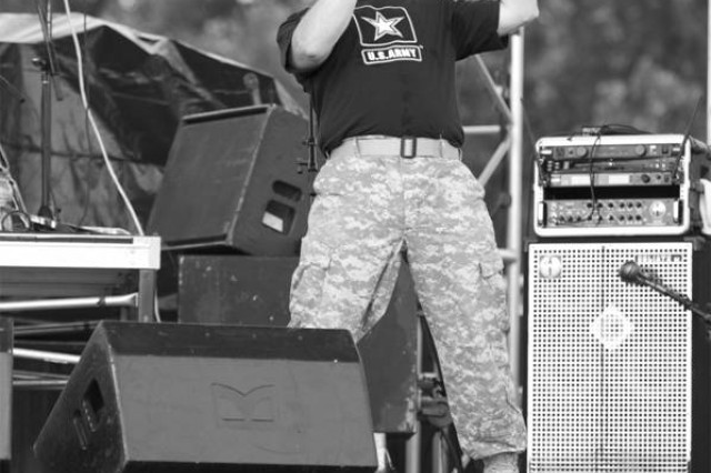 Staff Sgt. Randy Wight gives it his all as he belts out a tune at Country USA in Oshkosh, Wis.