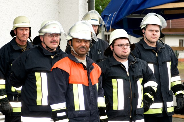 Master Sgt. Carl Childs (center), listens to a safety briefing with his fellow firefighters before a training session at the Mantel Fire Department.  Childs, the Enlisted Advisor at the 7th Army Joint Multinational Training Command (JMTC) Reserve Component Liaison Office in Grafenwoehr, Germany, is the only American volunteer on the staff of the small Bavarian town's fire department.