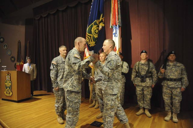Col. Donald E. Gentry (center) passes the colors to Brig. Gen. Edward C. Cardon, deputy commandant, Command and general Staff College, Combined Arms Center, Fort Leavenworth, Kan., during the Change of Leadership ceremonies June 29 at the U.S. Army Sergeants Major Academy. Gentry relinquished his command to Command Sgt. Maj. Raymond Chandler III, (left) who became the first enlisted commandant of the Academy since its inception in 1972.