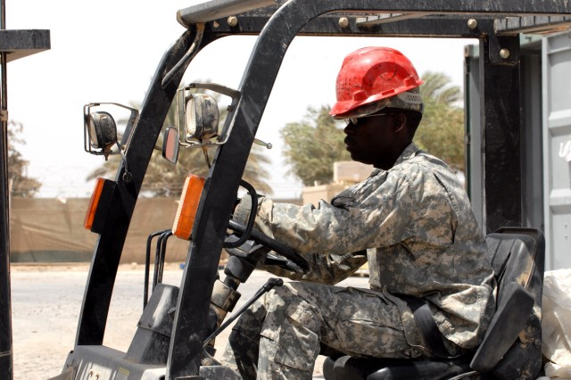 "BAGHDAD - Spc. Tammar Tucker, a Detroit native assigned to Company A, 299th Brigade Support Battalion, 2nd Brigade, 1st Infantry Division wears his personal protective equipment while he operates a forklift to unload pallets and store them at a warehouse on Camp Liberty, June 26.  ""Safety is my first priority when I am working,"" said Tucker."