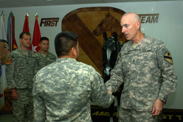 """BAGHDAD - Maj. Gen. Daniel P. Bolger, commanding general for 1st Cavalry Division and Multi-National Division-Baghdad greets retired Sgt. Marco Robledo  at Camp Liberty June 27 during a visit by retired and active duty Soldiers from the pilot program dubbed """"Operation Proper Exit."""" Robledo, who hails from Clarksville, Ark. and five other troops who were wounded but are in the process of healing from the emotional wounds of war, flew from the U.S. to spend time with their brothers and sisters-in-arms in Iraq."""