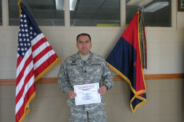 Lt. Col. Marcelo Nunez, a Chilean Exchange Officer, proudly shows off his diploma from the 82nd Airborne Division Advanced Airborne School. Nunez was the first foreign officer to complete the jumpmaster course on June26.  (Courtesy photo)