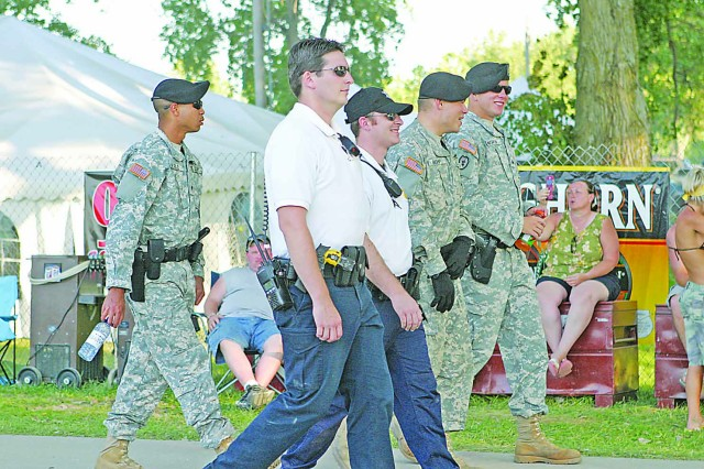 Three military policemen help patrol at Country Stampede festival grounds June 28 at Tuttle Creek State Park in Manhattan.