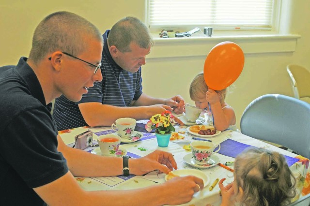 Daughters teach their fathers about tea party etiquette at ACS event