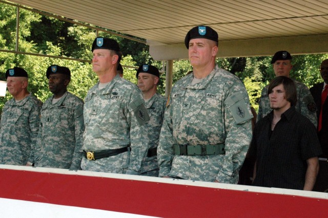 "Brig. Gen. Lynn Collyar, the 35th Chief of Ordnance and commanding general of the U.S. Army Ordnance Center and Schools, passes the brigadeAca,!a,,cs colors to new 59th Ordnance Brigade commander, Col. Howard Aca,!A""LeeAca,!A? Merritt, June 19."
