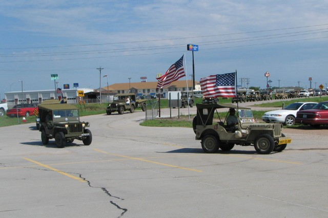 In a transcontinental trek that is expected to take about 26 days to complete, members of the Military Vehicle Preservation Association stopped for a respite at the Heartland Museum of Military Vehicles Friday for lunch and to inspect their caravan. The group is recreating the original trek across the United States by the  Army's Motor Transport Corps in 1919. It took 62 days for that group to travel 3,251 miles, averaging a little more than 50 miles per day, to cross from Washington, D.C. to San Francisco, Calif. Ten of those days were spent crossing the state of Nebraska, as the travelers traversed the state on the Lincoln Highway, later renamed Hwy 30.