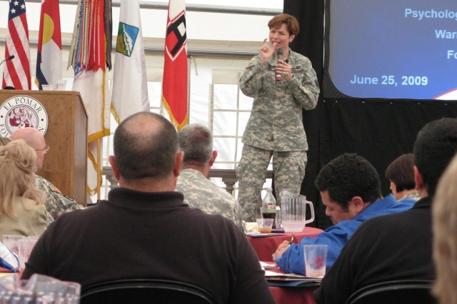 COLORADO SPRINGS, Colo.-Brig. Gen. Loree K. Sutton talks to the military and civilian audience during the Warrior Care Summit at El Pomar Foundation's Penrose House pavilion.