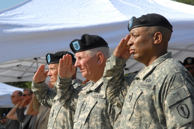 From left, Brig. Gen. Richard Mustion, outgoing commander of the Soldier Support Institute, Maj. Gen. James Chambers, commander of the Combined Arms Support Command, and Col. Mark McAlister, the new SSI commander, salute during the SSIChange of Command ceremony yesterday at the Officers' Club.