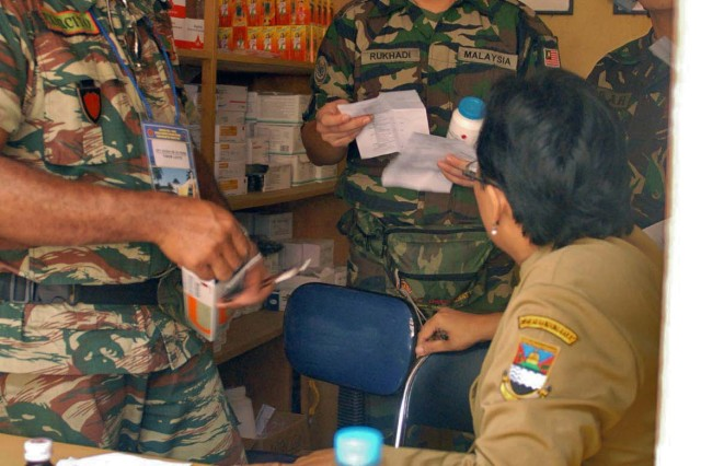 Pharmacists and pharmacy techs fill prescriptions for patients in Ciburuy Villiage, near Bandung, Indonesia, June 29 as part of the Medical Readiness Exercise Tendon Valiant. Doctors and medics from 12 countries provided medical care to nine sites in the Bandung area. Tendon Valiant is an annual, multi-national, Medical Readiness Exercise to improve security operation and medical interoperability between the nations. During the five-day exercise, the doctors and medics treated more than 2,000 patients.