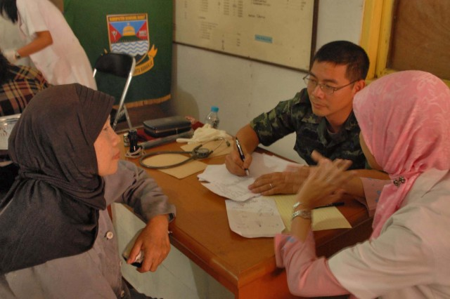 A doctor from Vietnam takes medical information from a patient in Ciburuy Villiage, near Bandung, Indonesia, June 29 as part of the Medical Readiness Exercise Tendon Valiant.  Doctors and medics from 12 countries provided medical care to nine sites in the Bandung area. Tendon Valiant is an annual, multi-national, Medical Readiness Exercise to improve security operation and medical interoperability.