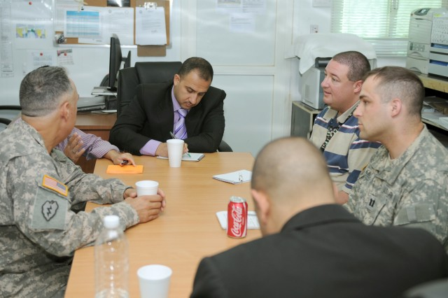CONTINGENCY OPERATING BASE SPEICHER, TIKRIT, Iraq - Ahmed Abed al-Jabar, the first deputy governor of Salah ad-Din province writes down information concerning civil reconstruction projects during a meeting with Coalition forces and civil engineers at the United States Army Core of Engineers regional headquarters, June 29.  Ahmed met with the USACE engineers to establish a direct working relationship and discuss upcoming projects to improve the lives of the people of the province. (U.S. Army photo by Spc. Jazz Burney, 3rd Infantry Brigade Combat Team, 25th Infantry Division Public Affairs)