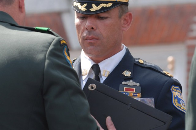 Maj. Gen. David A. Morris, commanding general of U.S. Army Civil Affairs and Psychological Operations Command (Airborne), presents the Welcome Home Warrior-Citizen Award to Sgt. 1st Class Daniel MacDonald, 304th Civil Affairs Brigade. MacDonald, as an Army Reserve Soldier with a civilian career, is a captain in the Philadelphia Police Department.