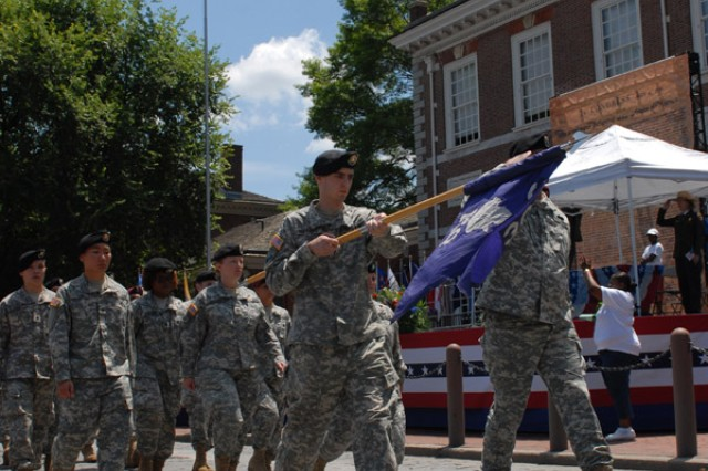 Soldiers from the 304th Civil Affairs Brigade salute Maj. Gen. David A. Morris, commanding general of the U.S. Army Civil Affairs and Psychological Operations Command (Airborne), during the Independence Day Celebration Parade. The 304th Civil Affairs Brigade, which recently returned from duty in Iraq where the unit assisted in rebuilding the country's government, also marched in the parade. USACAPOC(A) traces its roots back to when George Washington directed the Army to restore governance to Philadelphia in the late 1700s.