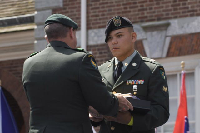 Spc. Patrick Camacho, 304th Civil Affairs Brigade, receives the Welcome Home Warrior-Citizen Award from Maj. Gen. David A. Morris, commanding general of U.S. Army Civil Affairs and Psychological Operations Command (Airborne) during Independence Day Celebration, July 4, in Philadelphia.