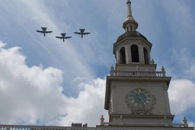 A10 Thunderbolts fly over Independence Hall during the Independence Day Celebration in Philadelphia, July 4. Soldiers from the 304th Civil Affairs Brigade, who recently returned from a deployment where they assisted in rebuilding Iraq, also marched in the parade. The U.S. military's history of conduction civil affairs operations can be traced back to when George Washington directed the Army to restore governance to Philadelphia.