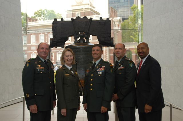 """Maj. Gen. David A. Morris, commanding general of the U.S. Army Civil Affairs and Psychological Operations Command (Airborne), National Park Service superintendant Cynthia McCleod, Col. Daniel Ammerman, commander of the 304th Civil Affairs Brigade, Lt. Col. Jay Shiffler, USACAPOC(A) Public Affairs Officer, and Philadelphia Mayor Michael Nutter pose in front of the Liberty Bell after participating in the Independence Day Bell Tapping Ceremony, July 4, in the historical district of Philadelphia. """""""