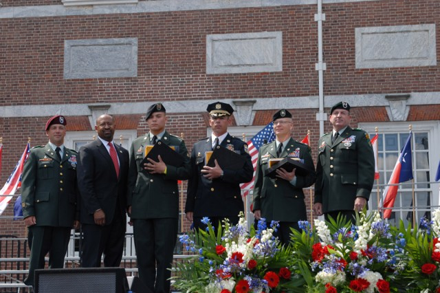 """From left to right, Col. Daniel Ammerman, Philadelphia Mayor Michael Nutter, Spc. Patrick Camacho, Sgt. 1st Class Daniel MacDonald, Lt. Col. John Anderson, and Maj. Gen. David A. Morris, commanding general of the U.S. Army Civil Affairs and Psychological Operations Command (Airborne), stand in front of Independence Hall after the three center soldiers were presented the Welcome Home Warrior-Citizen Award. Camacho, MacDonald and Anderson are Army Reserve Soldiers in 304th Civil Affairs Brigade, of Philadelphia, and recently returned from a year-long deployment to Iraq. """""""