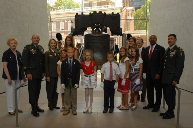 """Maj. Gen. David A. Morris, commanding general of the U.S. Army Civil Affairs and Psychological Operations Command (Airborne), and Col. Daniel Ammerman, commander of the 304th Civil Affairs Brigade, pose with the descendants of signers of Declaration of Independence in front of the Liberty Bell after participating in the Independence Day Bell Tapping Ceremony, July 4, in the historical district of Philadelphia. """""""