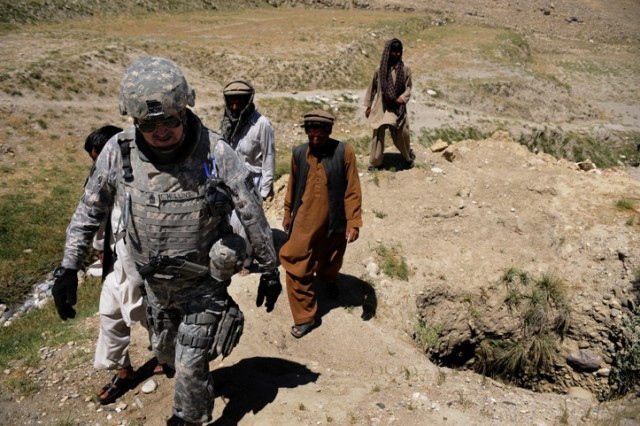Sgt. Maj. Matthew Mullins, Nangarhar Agri-Business Development team chief, conducts a site survey in Rodat, Afghanistan, May 28. The Agri-Business Development Team is responsible for developing and monitoring projects which will improve the agricultural production of the rural farming communities.