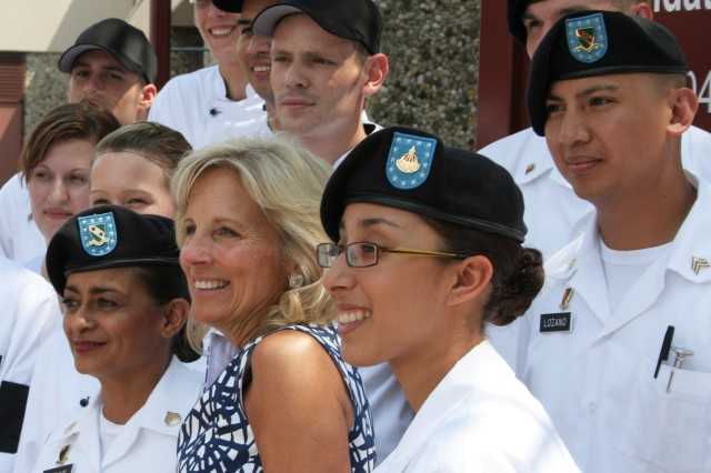 Soldiers and local national workers from the Nieves Webb Dining Facility pose for a picture with Dr. Jill Biden. Biden visited Bamberg on July 3 and Schweinfurt the following day.