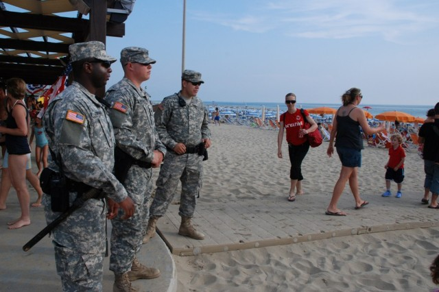 Soldiers from the 511th Military Police Platoon in Camp Darby, Italy make sure everyone stayed safe at the Independence Day celebrations at the American beach.