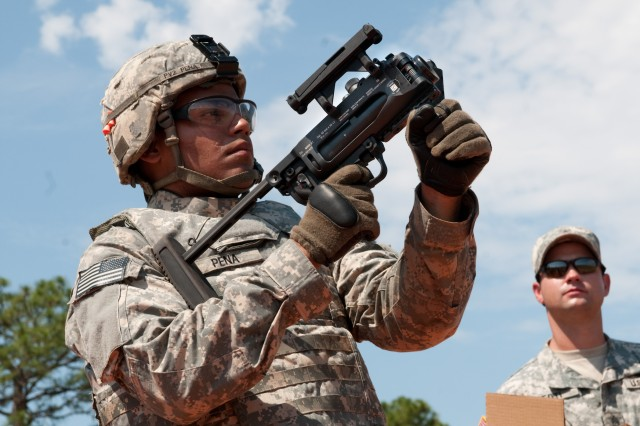A paratrooper with 1st Brigade Combat Team, 82nd Airborne Division, fires a training round from the new M-320 grenade launcher while learning to use the weapon on a Fort Bragg, N.C., range July 1. The brigade is the first unit in the Army to receive the advanced grenade launcher that will replace the Vietnam-era M-203.