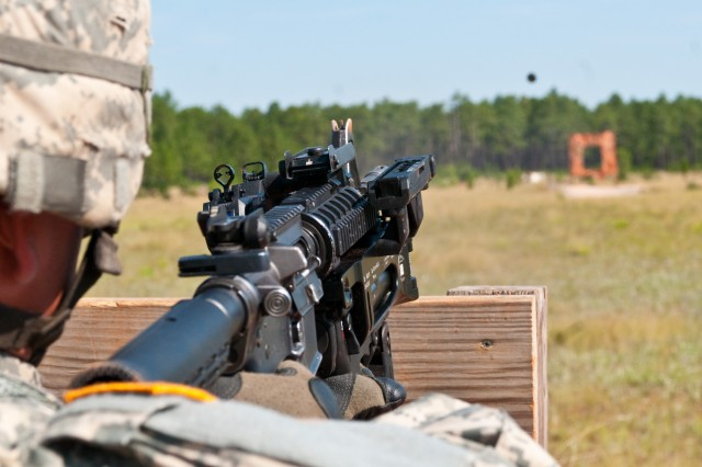 A paratrooper with 1st Brigade Combat Team, 82nd Airborne Division, fires a training round from the new M-320 grenade launcher while learning to use the weapon July 1, at Fort Bragg, N.C.