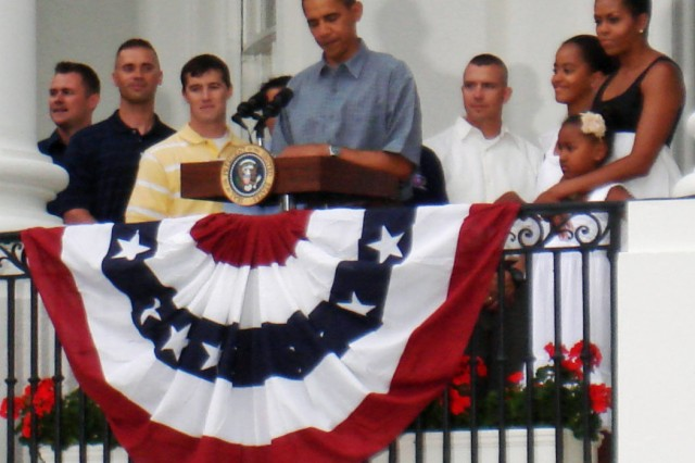 President Barack Obama speaks to military families on the South Lawn during an Independence Day celebration at the White House in Washington, D.C., July 4. Joining the president at the podium are 22 servicemembers handpicked by their services for recognition at the event.