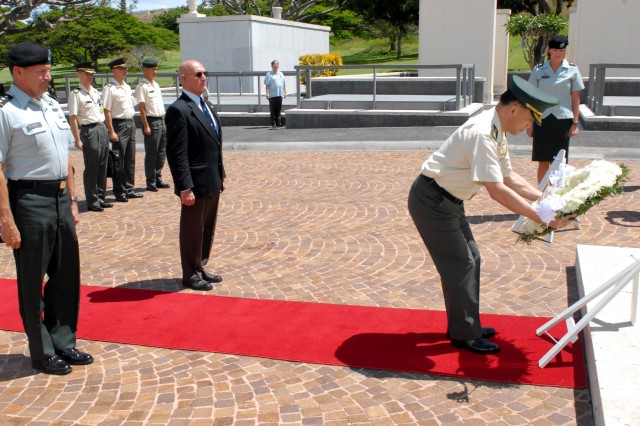 HONOLULU, Hawaii - Lt. Gen. Benjamin R. Mixon, commanding general, U.S. Army, Pacific, and Gene Castanetti, director of the National Memorial Cemetery of the Pacific, watch Gen. Yoshifumi Hibako, chief of staff, Japan Ground Self Defense Force, present a wreath in honor of fallen Soldiers from past conflicts, July 7, at the National Memorial Cemetery of the Pacific. Approximately 20 Japan Self Defense Force personnel are attending the U.S.-Japan Senior Leader Seminar to discuss topics concerning both countries.