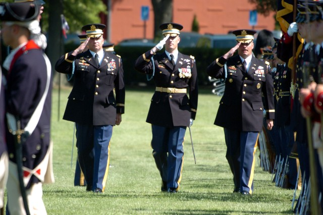 From left to right, Col. David P. Anders, incoming commander of the 3rd U.S. Infantry Regiment (The Old Guard), Lt. Col. Eric Weis, the Regimental Executive Officer and Col. Joseph P. Buche, outgoing commander, inspect the troops during the change-of-command-ceremony on Summerall Field.