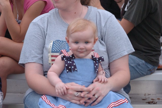 """Sarah Quintero enjoys the Twilight Tattoo """"Salute to the Nation"""" with her 9 1/2 month-old daughter, Emileigh, on Cottrell Field, July 2."""